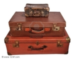 vitaminka_8350061-three-old-suitcase-stacked-with-different-size-isolated-on-white.jpg